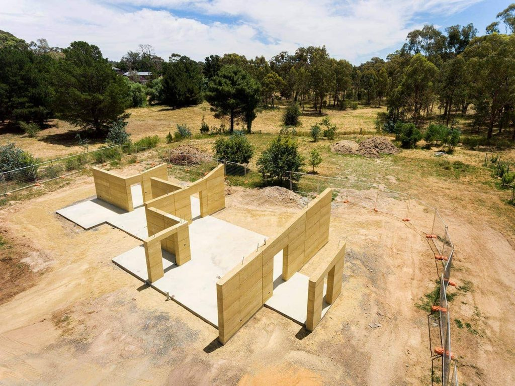 design of home with internal and external rammed earth walls