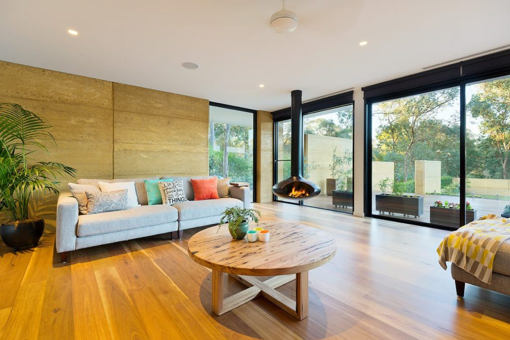 architecturally designed home utilising internal rammed earth walls