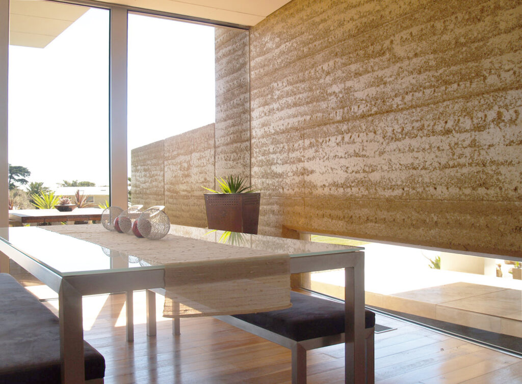 internal-rammed-earth-dining-room-feature-wall