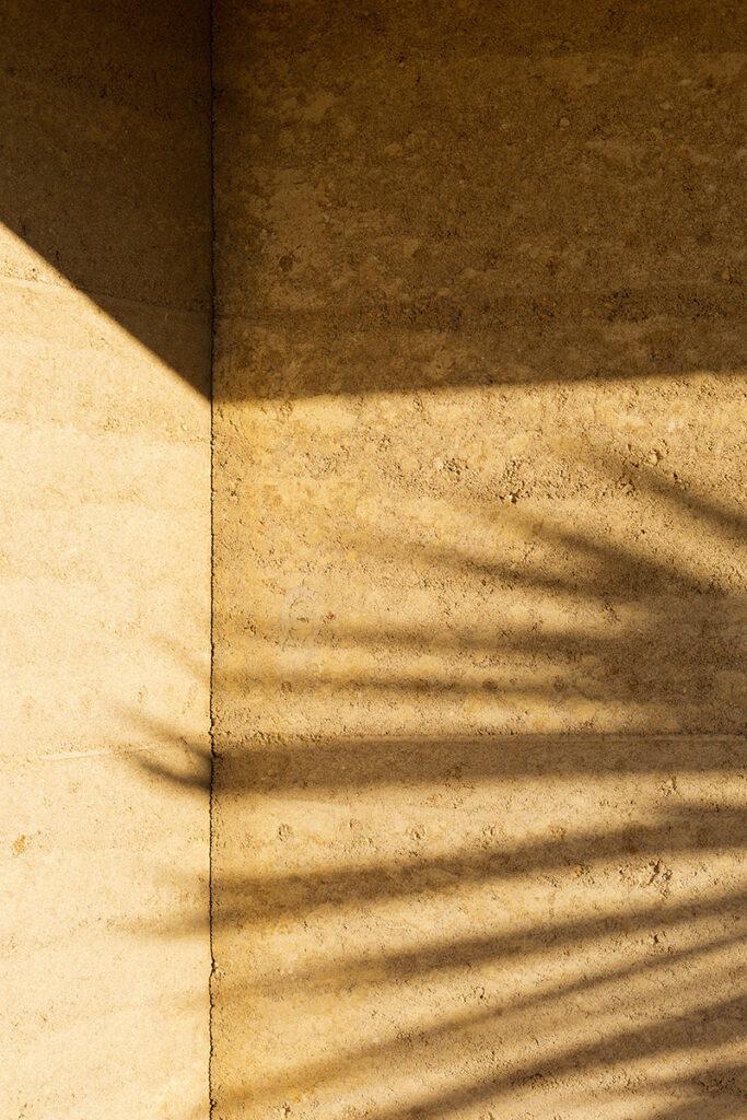 rammed-earth-texture-corner-shadow