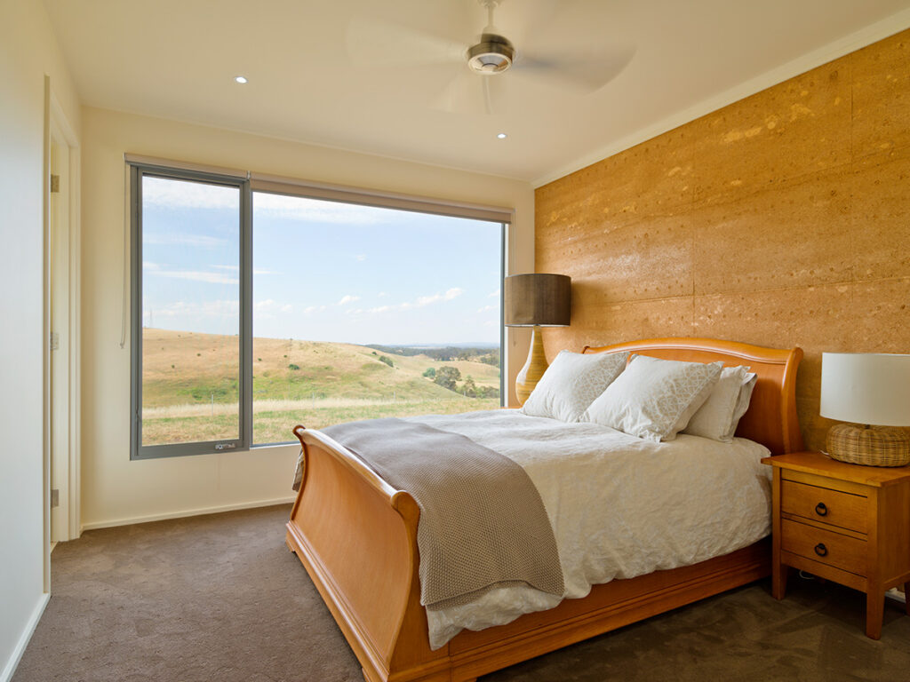 internal-rammed-earth-cosy-bedroom
