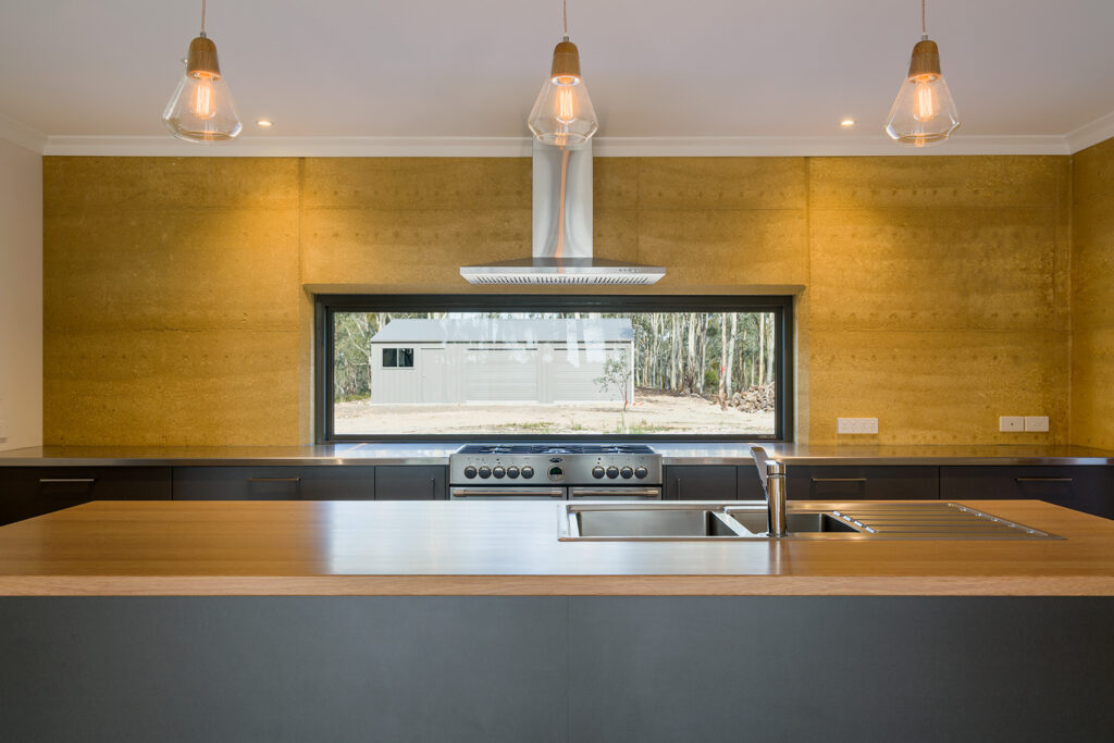 internal-rammed-earth-kitchen-feature