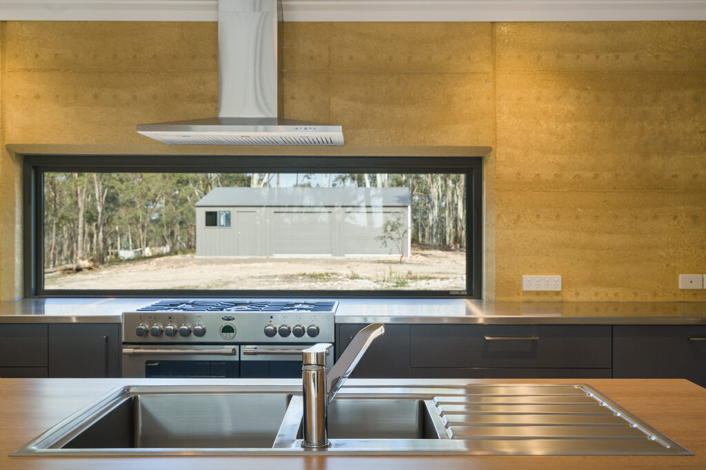 internal-rammed-earth-kitchen-feature-wall