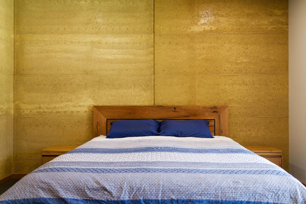 internal-rammed-earth-bedroom-feature-wall