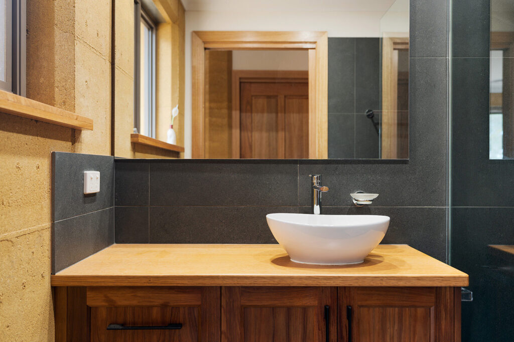 internal-rammed-earth-bathroom-wood-joinery