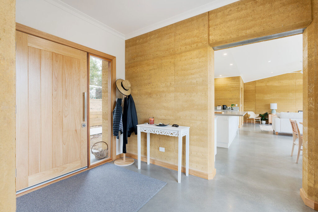 internal-rammed-earth-minimalist-entry-door