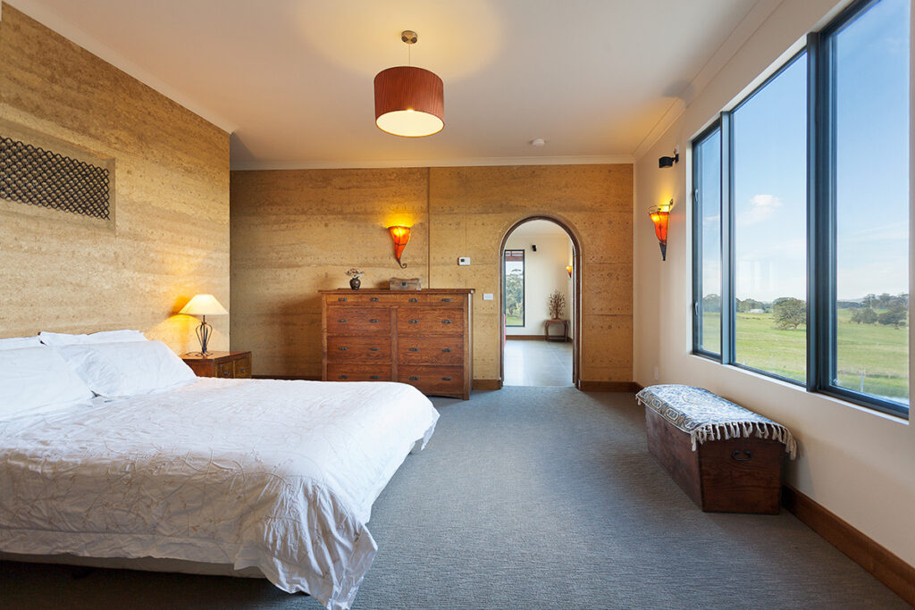 internal-rammed-earth-bedroom-feature-art